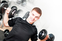 Young man with dumbbells