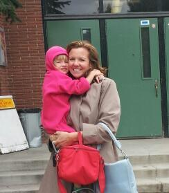 Emilia with her Mom, Michelle, in front of her new school