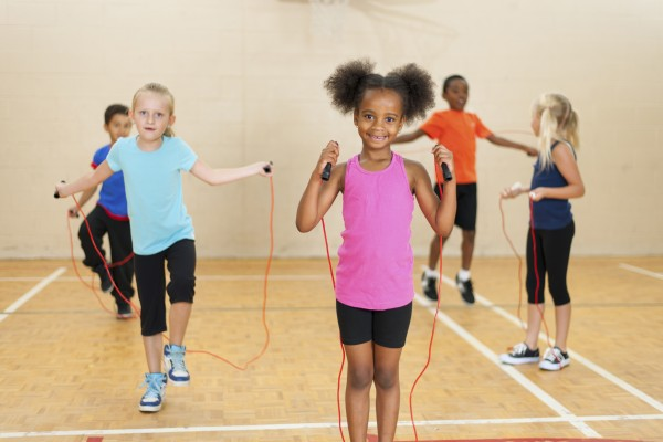 Kids skipping in gym class.