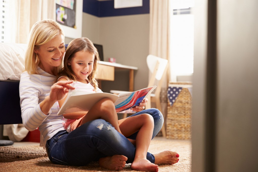 41393038 - mother reading with young daughter
