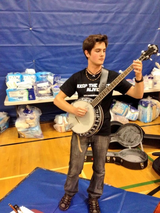Aiden from Bishop Carroll High has volunteered to play for elderly evacuees